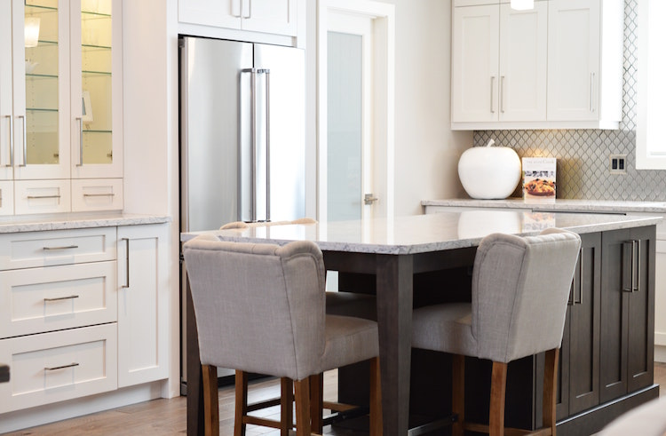 kitchen with stained wood island and granite countertops