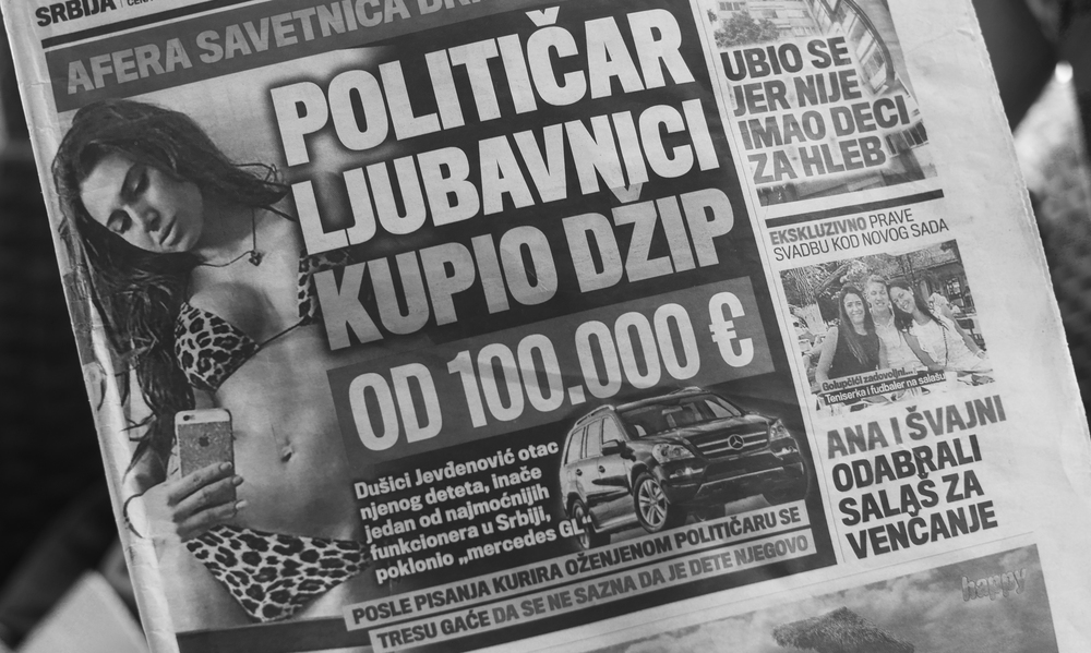 """Example of an average newspaper front page, on the left """"Politician gifted mistress 100,000 euro Jeep -one of the most powerful officials in Serbia, who is the father of his misstress's daughter, 'gifted' her a Mercedes GL"""", on the right """"Man kills himself because he didn't have enough money to buy his children bread""""."""