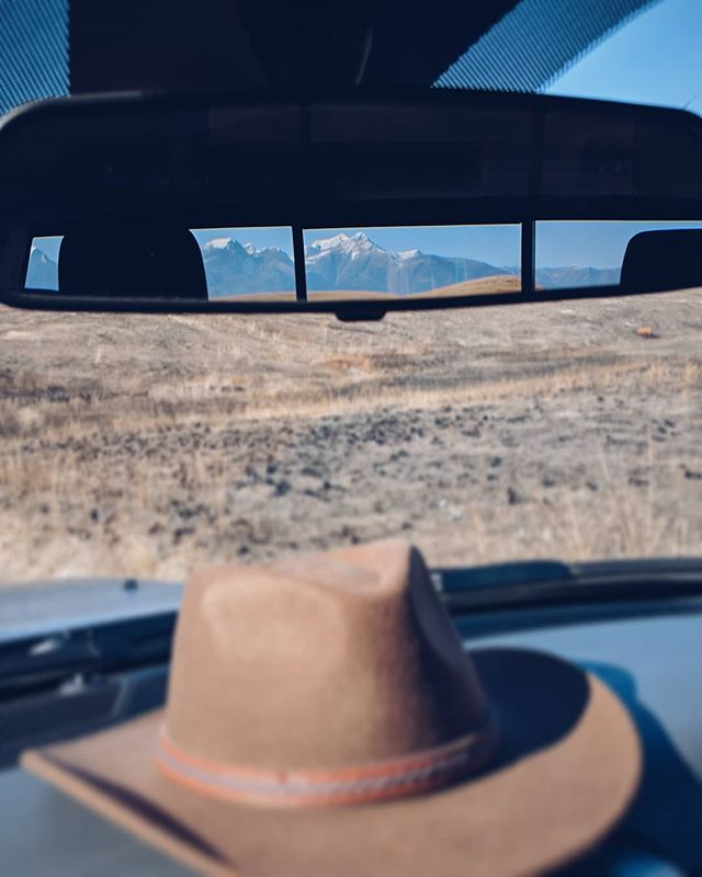 Playing cowboy this week. National upgraded us to a pickup, we're roaming prairies looking for bison, and I'm spying mountains in my rearview mirror.