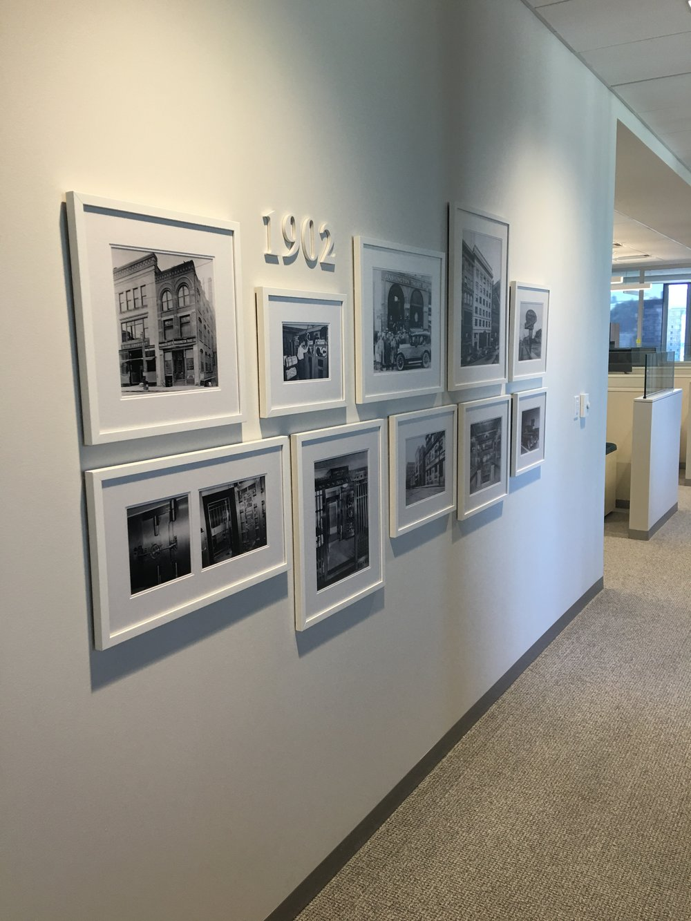 gallery wall, custom framing, design, signage, black and white photo wall