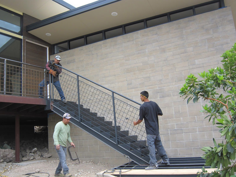 All Metal Fab's guys installing the stair railing