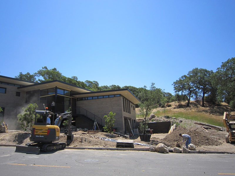 Final grading on rock walls at the front of the house