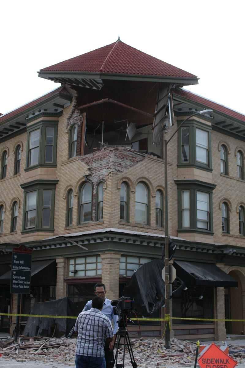 The destroyed front facade of a masonry building in downtown Napa, California seen in a post-earthquake photo. (August 24, 2014). Image credit Matthew Keys, used with permissions of Creative Commons Attribution No Derivatives 2.0 license.