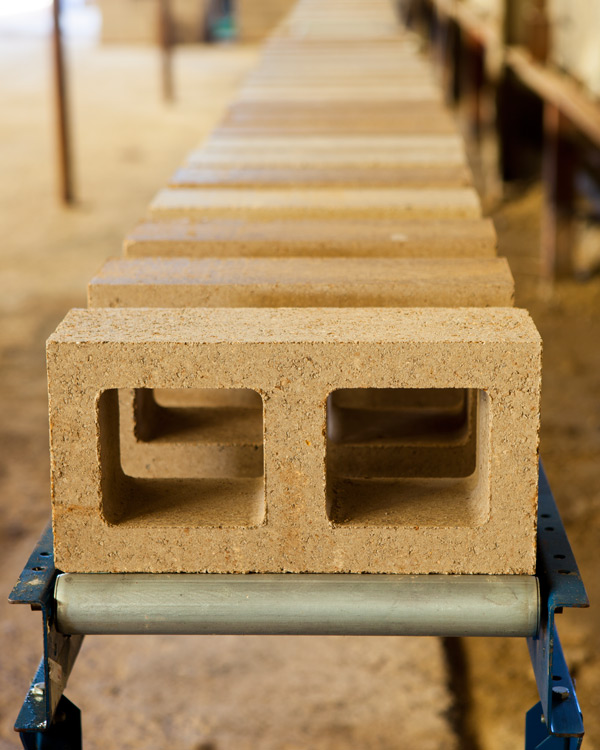 Low cement Watershed Blocks, made with locally sourced recycled aggregate, on the factory production line.