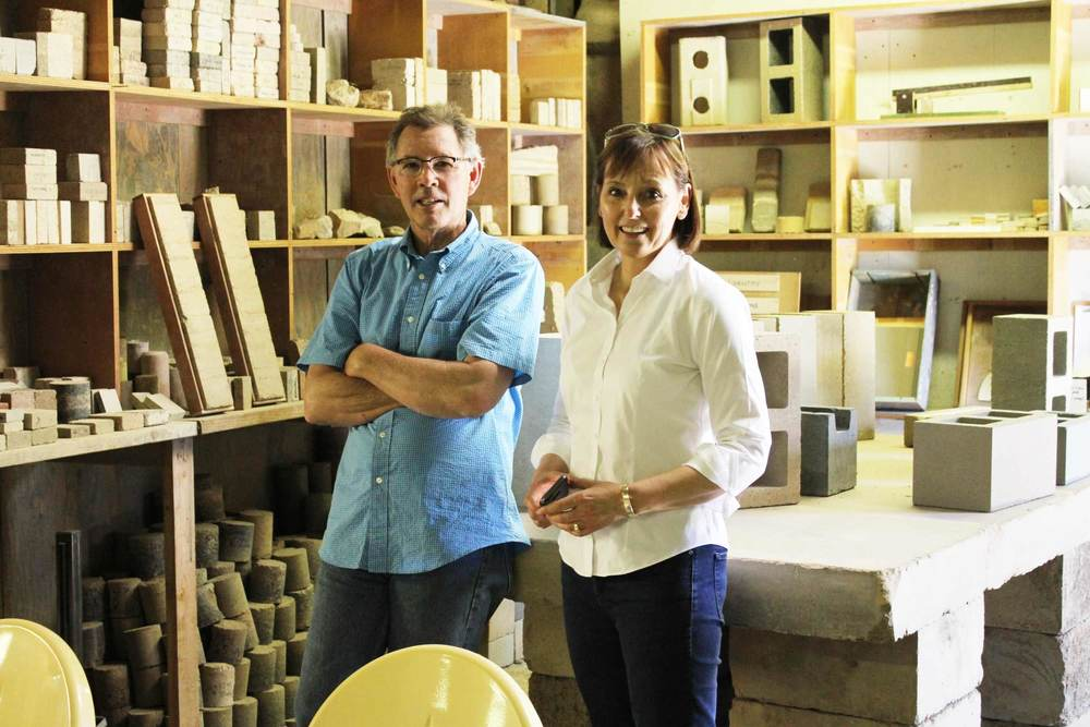 David Easton of Watershed Materials and Gaye Quinn of Westlake Urban at Watershed Materials' lab in Napa, California, discussing the viability of making structural masonry units from repurposed excavation from the Kirkham Project in San Francisco.