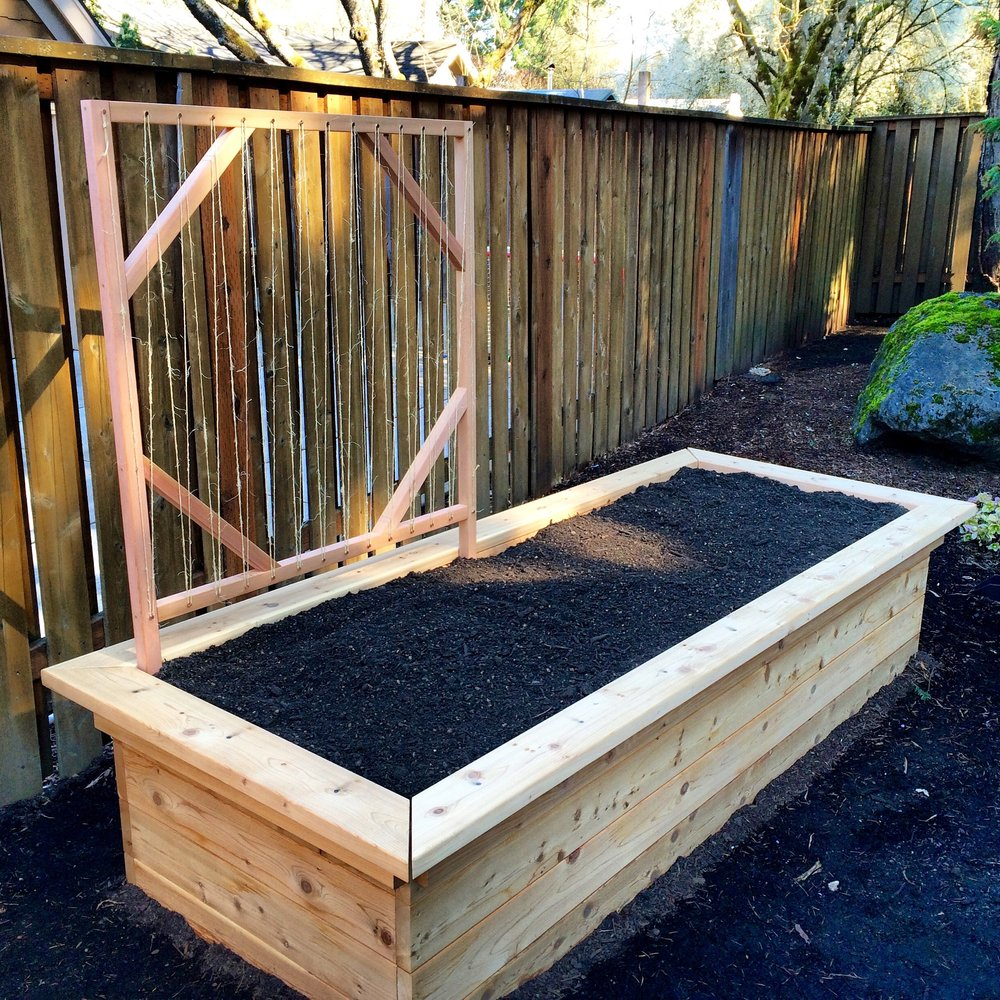 Customize your raised garden bed with built-in benches or a trellis for growing climbing vegetables