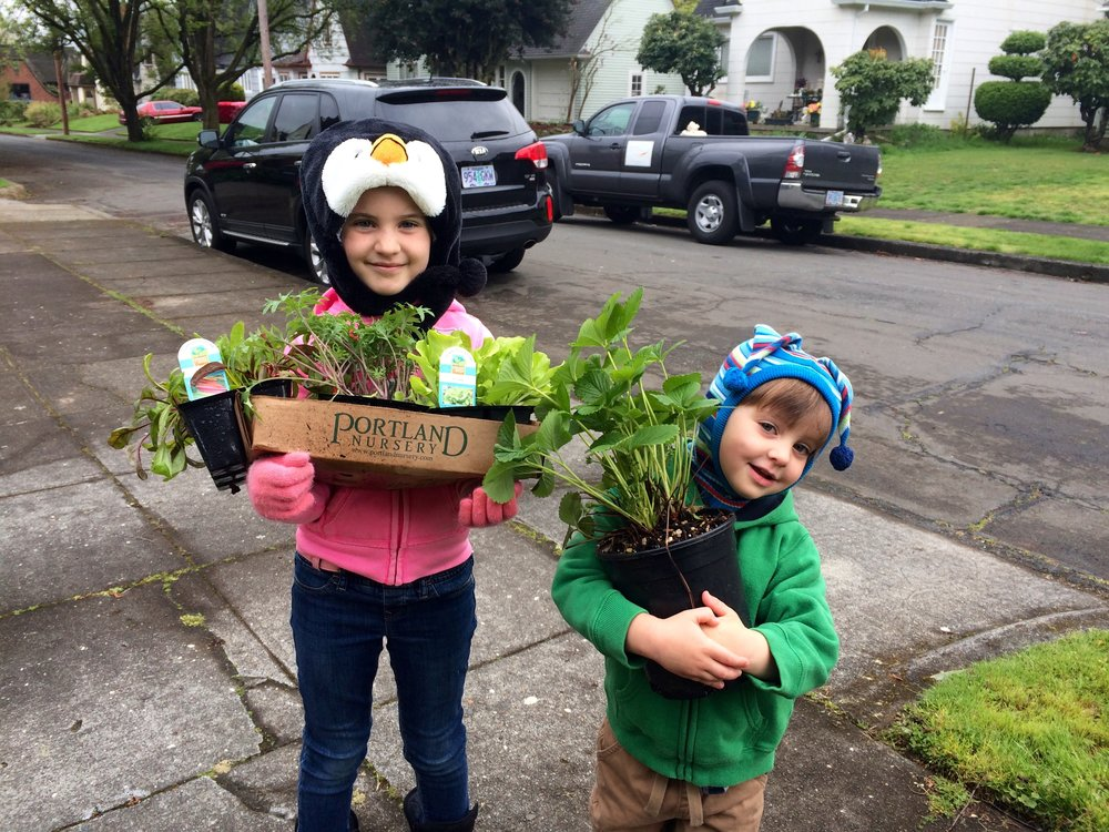I took this photo four years ago planting with these two cuties