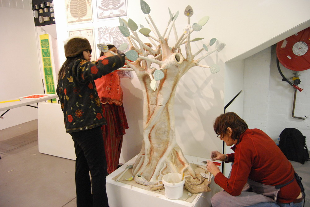 Minhazz Majumdar Pushpa Kumari and Ann Ferguson installing Universal Tree in the Easey Street Gallery