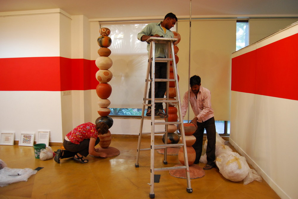 Ann Ferguson, Jugdish Prajapat and Mahavir installing pieces in the Visual Art Gallery , India Habitat Centre