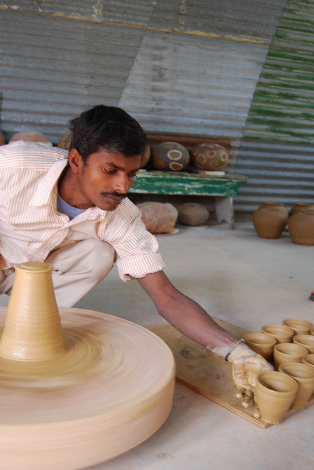Taking chai cup from the wheel