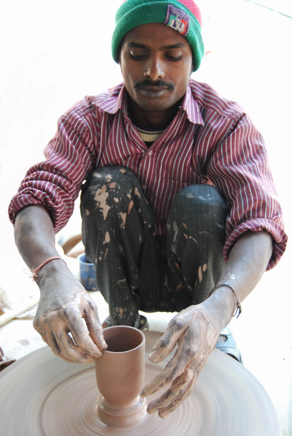 Banay Singh making beakers.