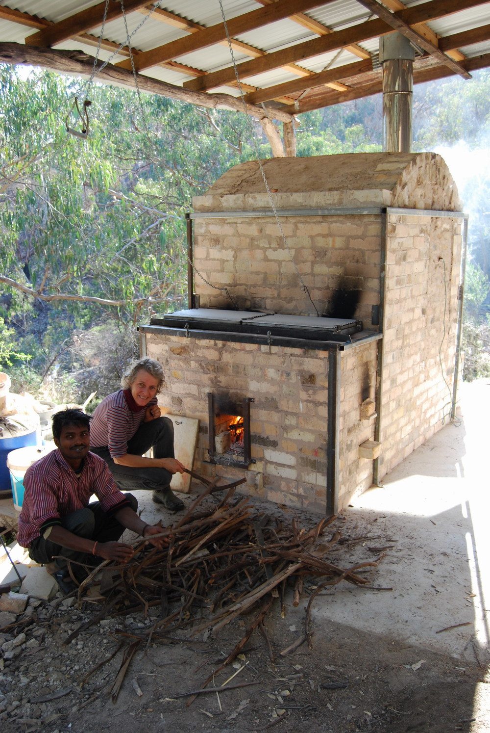 Banay Singh and Sandra Bowkett firing the kiln.