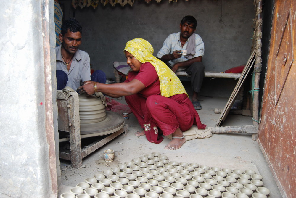Vimla Devi takes dya from the pottery wheel.
