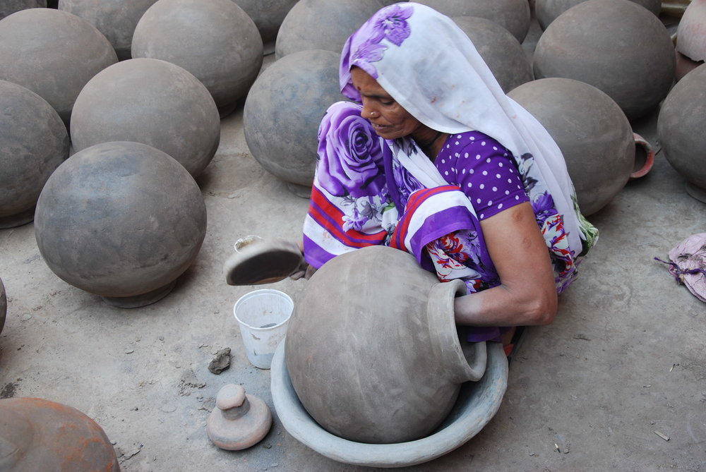 Fullwanti Devi beating out water pots