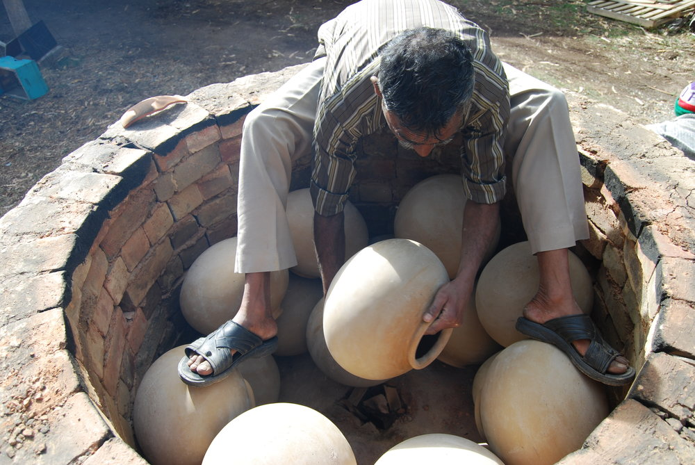 Manori Ji packing the kiln.JPG