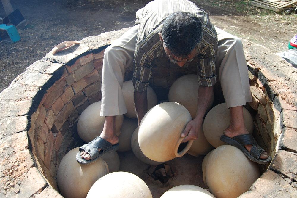 Manori Ji packing the kiln.JPG
