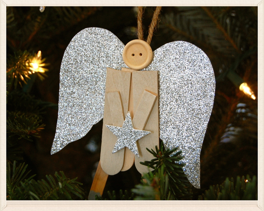 angel ornament popsicle sticks . glitter cardstock . twine . wooden button *self-imposed DIY - did alongside bubba and lucy at children's christmas party @ church (insert impish grin)