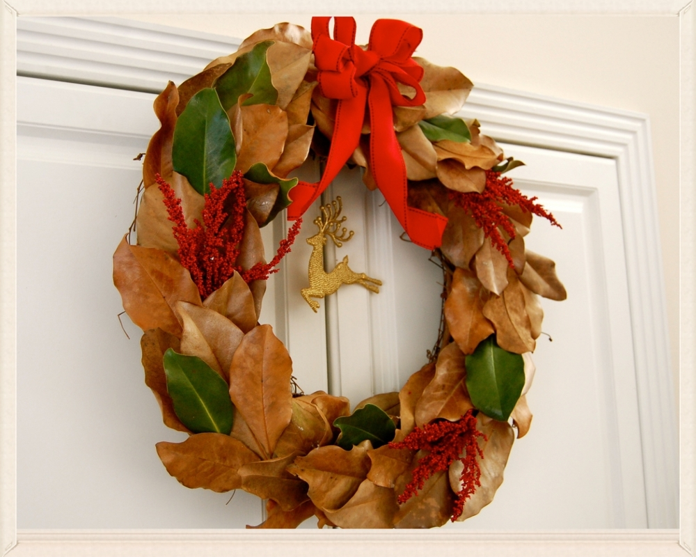 magnolia wreath magnolia leaves . grapevine wreath . fabric ribbon . Christmas picks . hot glue gun
