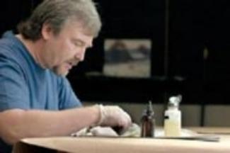 Joe Abbrescia Jr working in his restoration studio.
