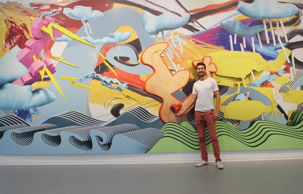 8_Степан Рябченко на фоне своей работы Лимонные цыплята спасутся... в рамках 3rd Danube Biennale. Danubiana-Meulensteen Art Museum, Братислава, Словакия.jpg