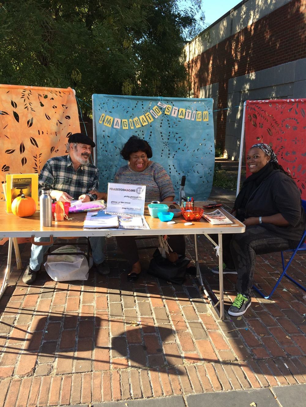 Citizen Artists Lenny Belasco, Juliette Quoquoi and Tieshka Smith hold down the Germantown Imagination Station.  (Photo by Yolanda Wisher, October 2016)