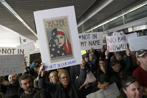 This SFO protest features a free downloadable image by Shepard Fairey, part of WE THE PEOPLE.
