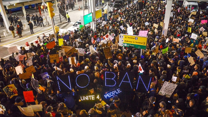 Protestors at JFK. (Photo: Stephanie Keith, Getty Images)