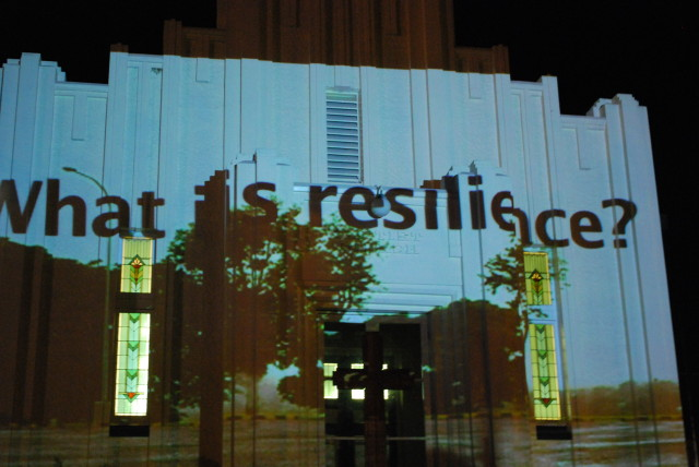 After flooding in Queensland, Australia, teens in Ipswich were asked to define resilience. Their responses were projected for the Writing's Off the Wall project, part of the Creative Recovery Program. Photo © Scotia Monkivitch from   Public Art Review .