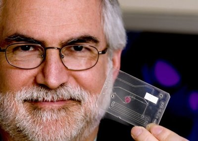 Paul Yager with a lab-on-a-chip that detects malaria