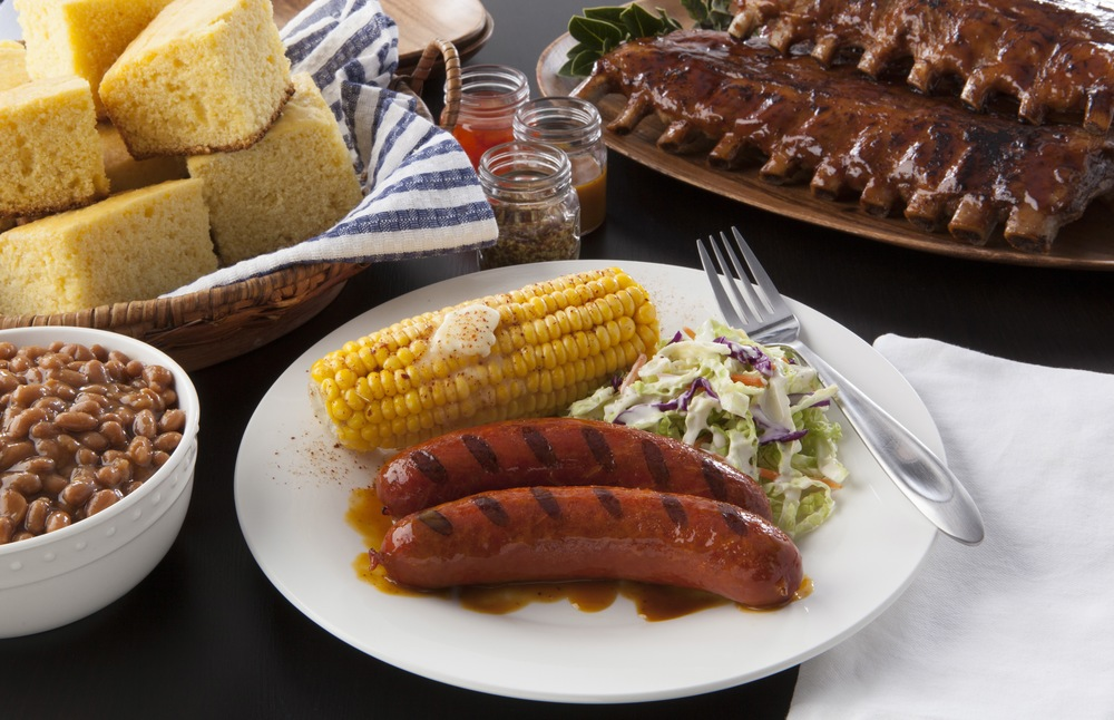 AAA Auto Insurance Commercial.  BBQ Louisiana Hot Links, Corn, Bushes Baked Beans, Cole Slaw, Corn Bread.