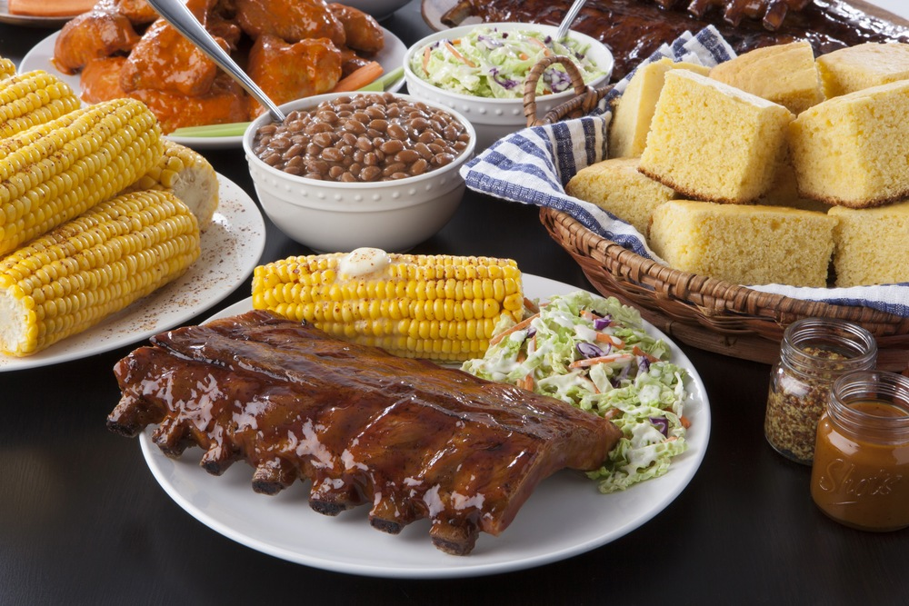 AAA Auto Insurance Commercial.  BBQ Baby Back Ribs, Corn, Bushes Baked Beans, Cole Slaw, Corn Bread, Chicken Wings.