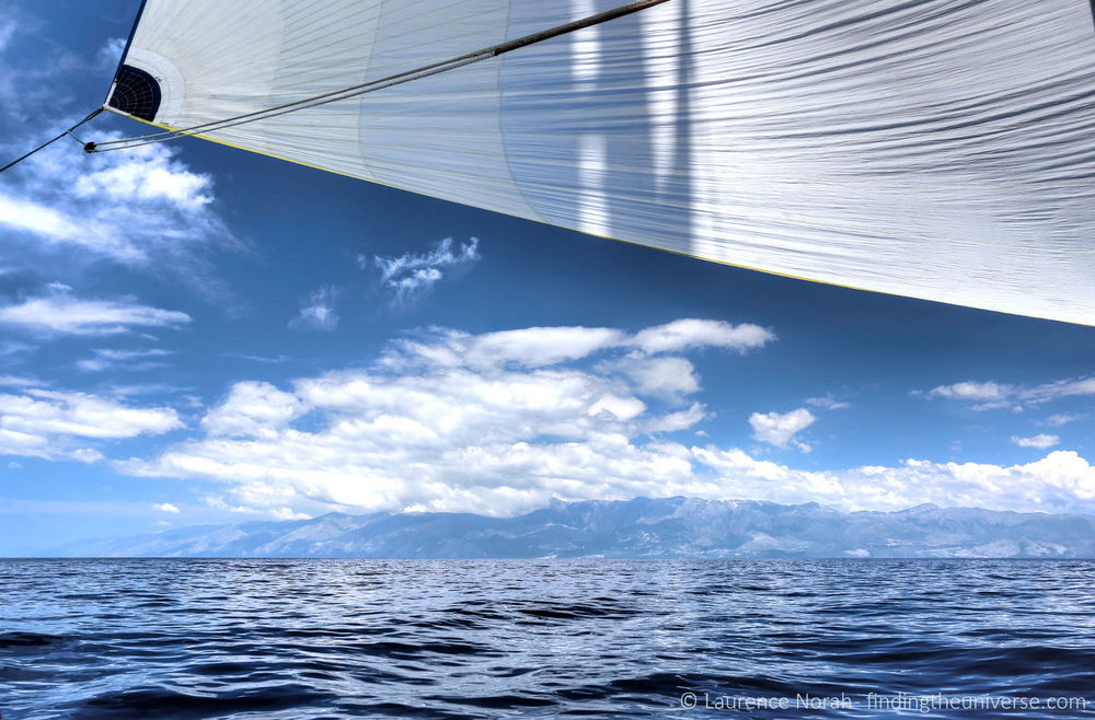 Blue sail sea sky mountains clouds scaled.jpg