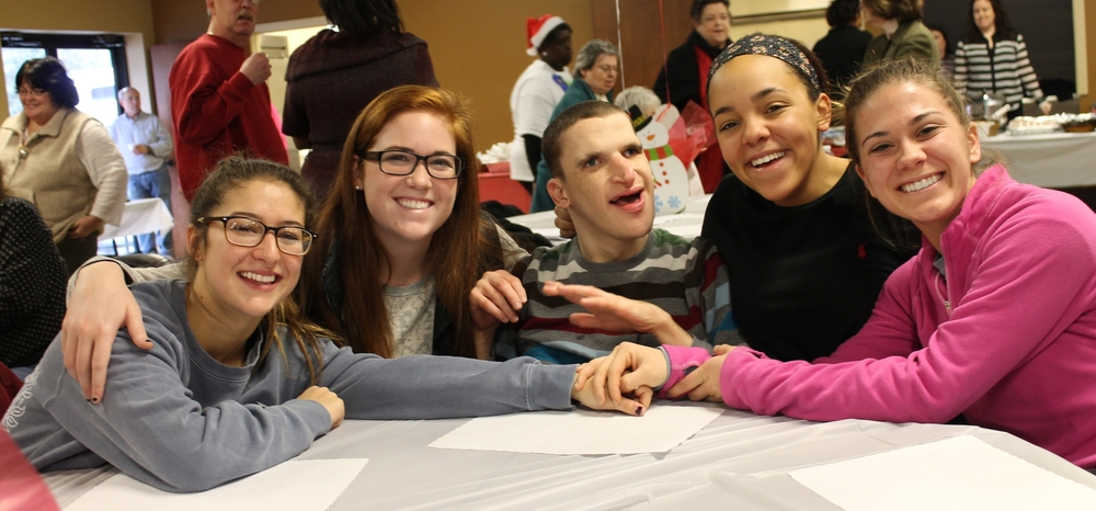 Nick, his sister, and their friends at Rauch's Holiday Potluck luncheon