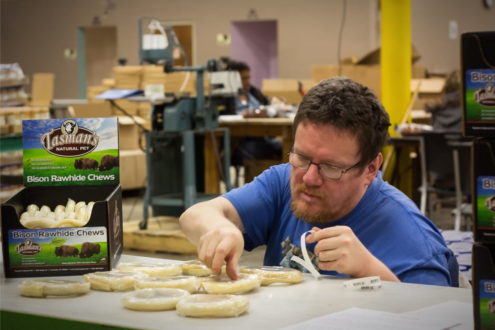 David,  worker at Rauch Industries, labels Tasman Natural Pet products