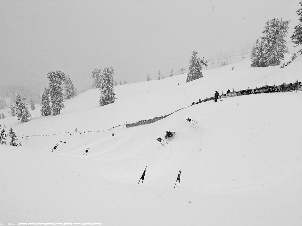 "an unidentified rider makes his way through turn 3 of the banked slalom course in ""low-viz"" conditions."
