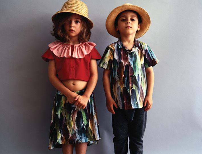 Girl: Raquel Red short cut blouse €45,00 - Fernanda Feathers skirt€45,00. Boy: Bruno Feathers shirt€55,00 - Henrique Grey pants€32,00.
