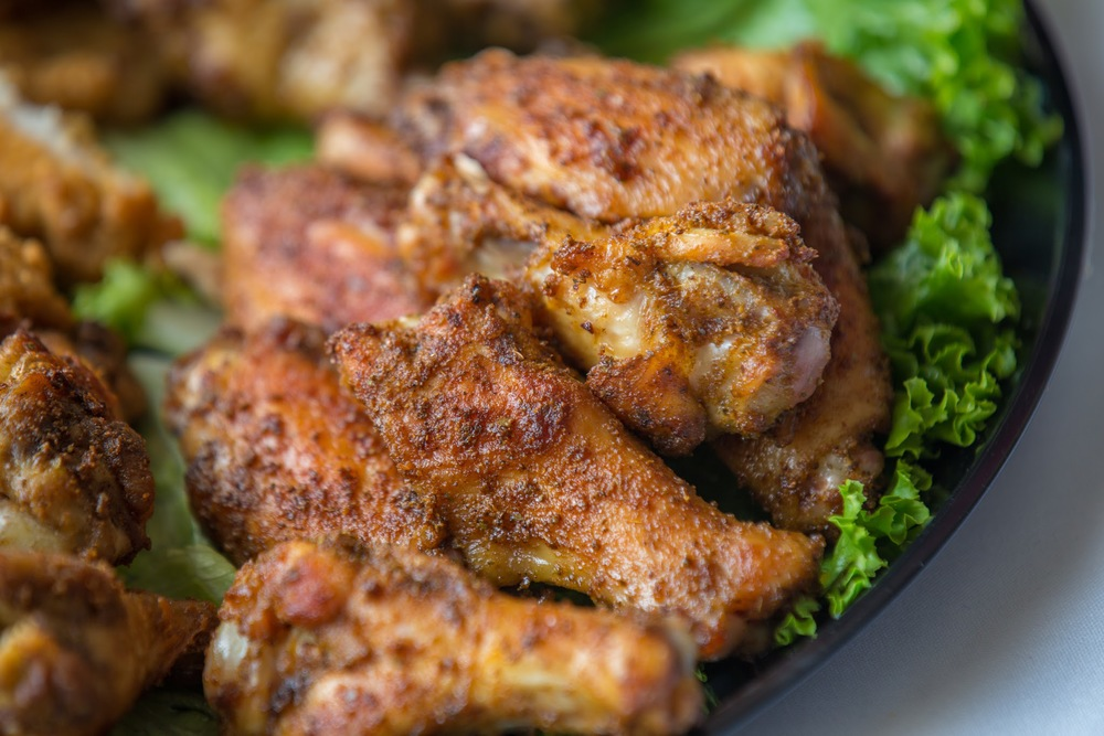 A family favorite for the last 20 years - roasted chicken wings with our spicy, signature Old Bay-based seasoning