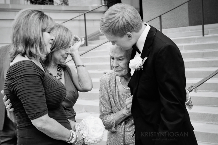 "This photo perfectly displays what Kristyn says she values most in photographing a wedding day, ""We are always mindful of being aware of what's going on around us, looking for those moments that only happen once and are cherished for a lifetime."""