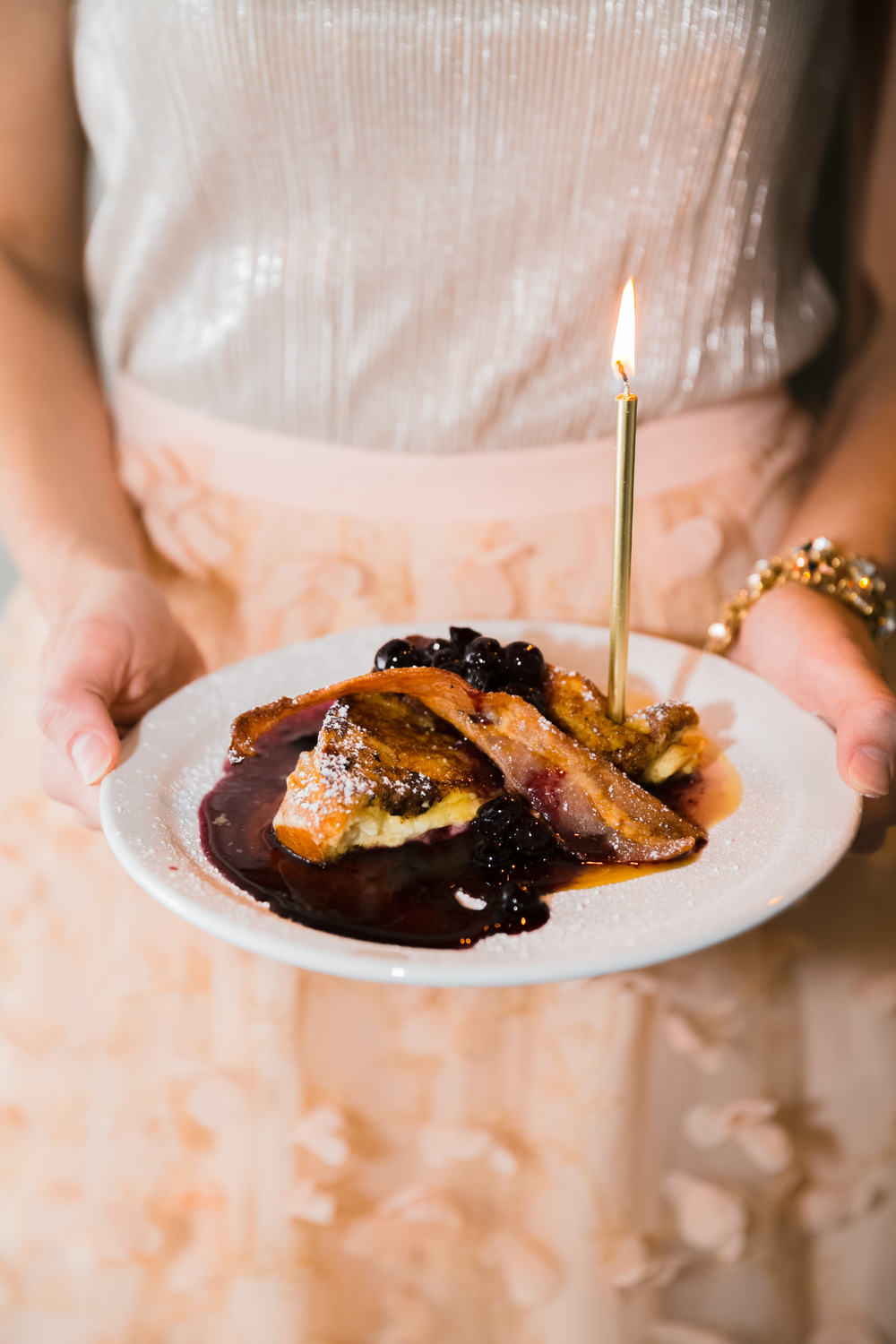 Yes, that is French Toast topped with bacon, blueberries and powdered sugar with mascarpone in between. Yum! Each piece was hand delivered to every guest with a candle glowing. I wanted each guest to feel honored and celebrated, which made this one of my favorite party moments. French Toast by Trattoria Centrale.