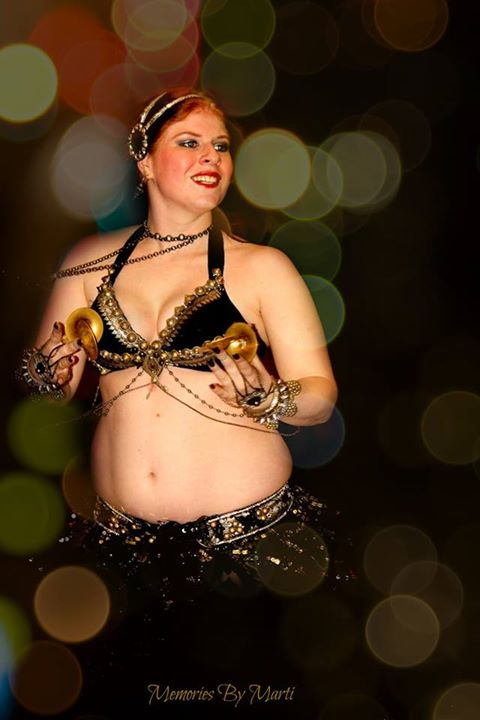 Amani performing with her favorite prop, finger cymbals, @ the Kashmir Nights Hafla.