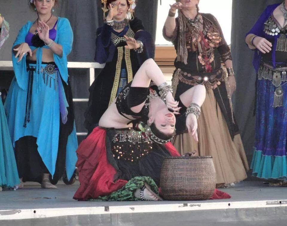 Amani caught mid-backbend while bellydancing @ the 2015 Florida State Fair.