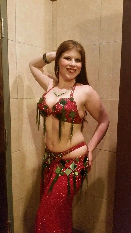 Amani posed pre-performance @ a private party. Costume by Asmahan Show.