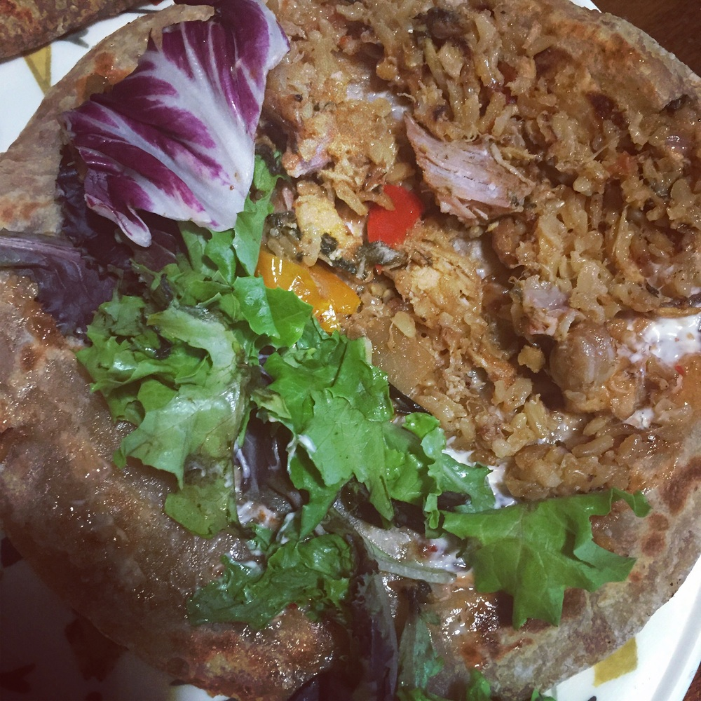 I schmear Maggie's chili sauce (also available at the Pakistani grocery store) and a little bit of tartar sauce on one side of the Paraatha before adding on the stir fry and salad. Roll it up!