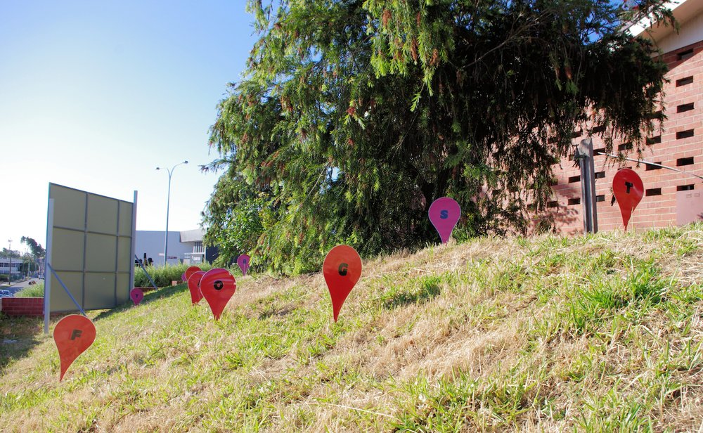 "A location pointer alphabet populated the garden, referencing the ""pins"" on Google maps. These location points were movable and we encouraged people to change the arrangement of these points."