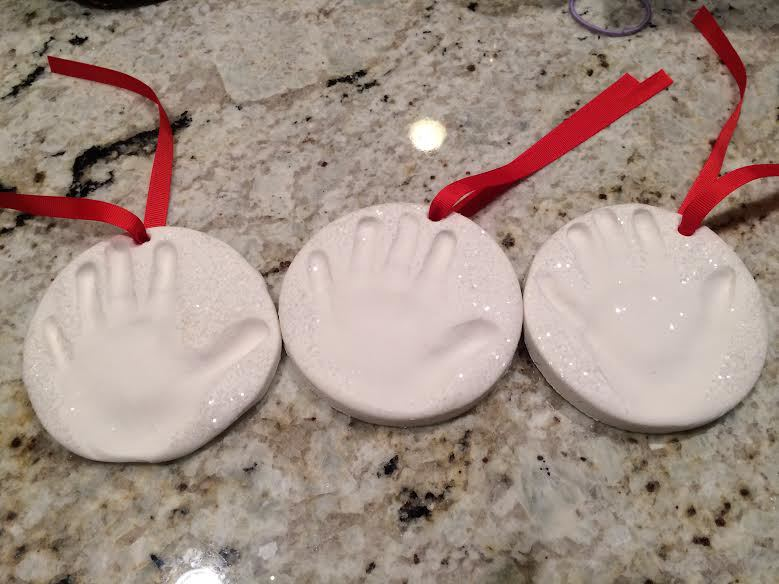 The ornament on the left, I accidentally forgot and removed the cookie cutter before doing the hand print-- you can see the difference in how it makes the finished product look!