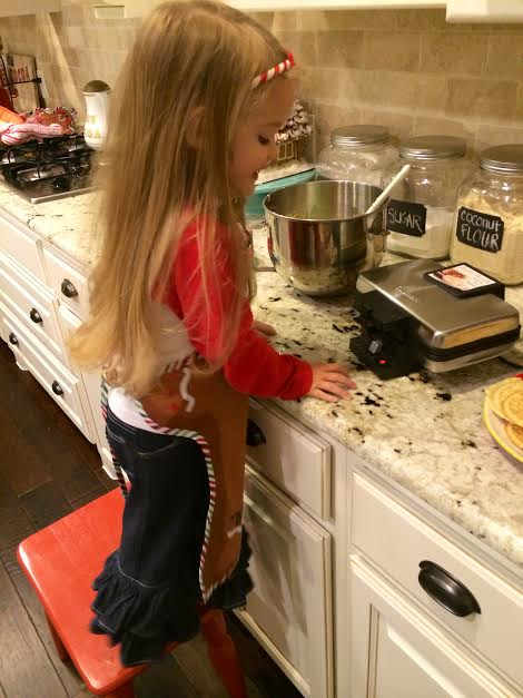 My baking buddy, Holiday Jane, carefully watching for the Pizzelle Press indicator light to turn green!