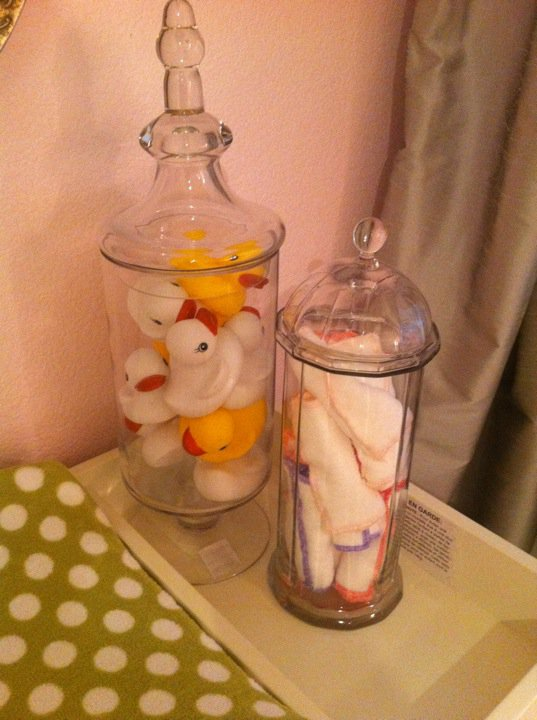 Beautiful glass pieces can work in any room!  This rubber ducky filled apothecary jars was one of my most favorite elements in baby Holiday's nursery!  The other glass straw container has rolled cloth wipes