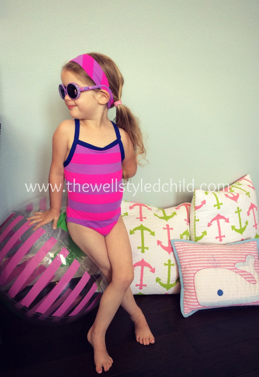 Garnet Hill Kids Wave Rider Cross Back One Piece Rugby Stripe Swimsuit  Garnet Hill Kids Swim Headband  Sunglasses:  The Disney Store