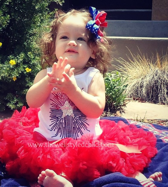 Holiday's first Fourth of July!  Just 8 months old!  I purchased the tutu at a local children's boutique and then found the sparkly/blingy tank top at Kids-R-Us.  These are the days before I really got into boutique fashion, but she still looked super cute and this would be an easy look to replicate on a budget!