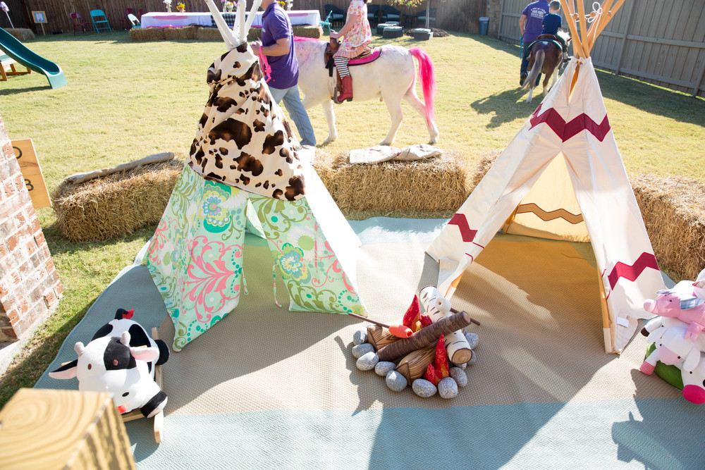 "I had the idea that I wanted to create a little enclosed play area and this turned out to be a huge HIT with all of the under 5 crew!  The teepees were full and many campfires were ""made"" throughout the entire party!"